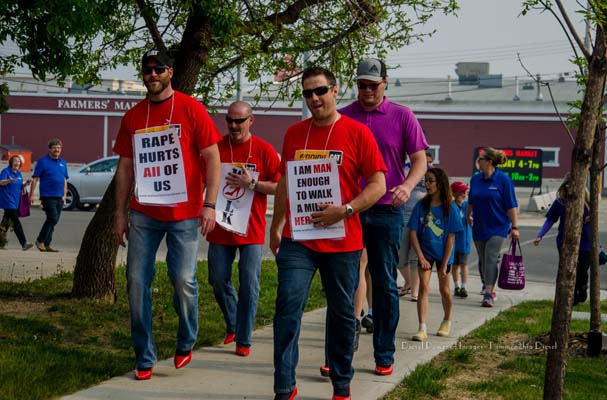 The 2019 Walk A Mile in Her Shoes campaign struts through the Swan City